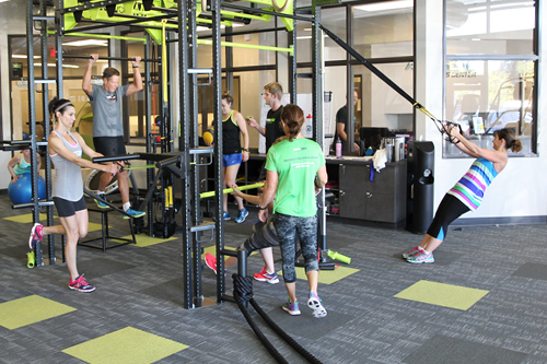 gym members exercise on universal machine