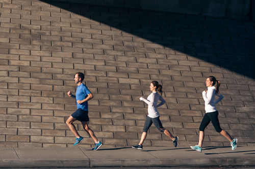 one male, two females running