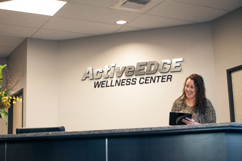 female at reception desk for physical therapy business