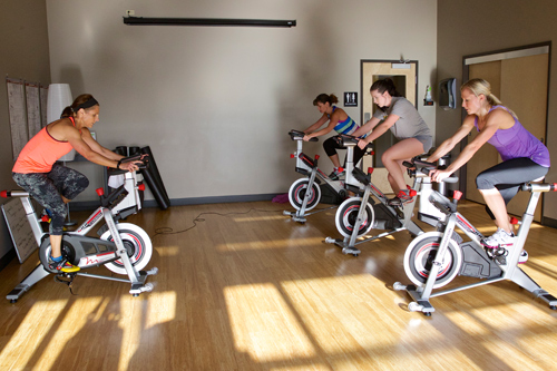 people in group cycling class
