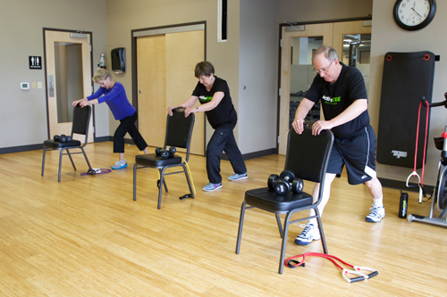 people performing exercises in senior fit class
