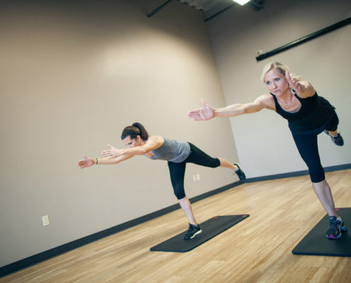 two female holding yoga pose