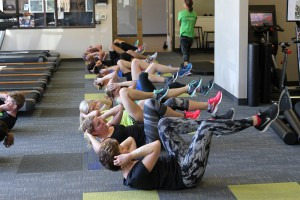 People performing bicycle crunches